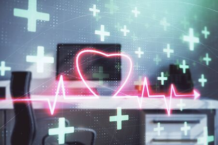 Heart hologram with desktop office background. Double exposure. Concept of medical education Stok Fotoğraf
