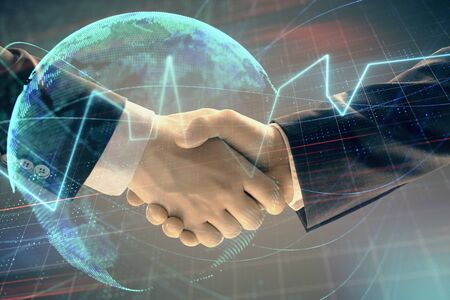 Multi exposure of forex graph and world map on abstract background with two businessmen handshake. Concept of success on international markets