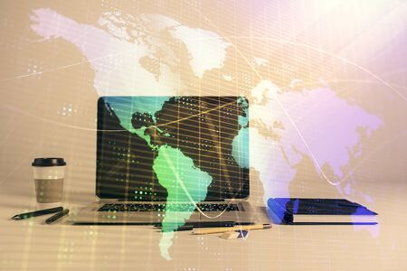 Map hologram and desktop office computer background. Multi exposure. Concept of international business Stockfoto
