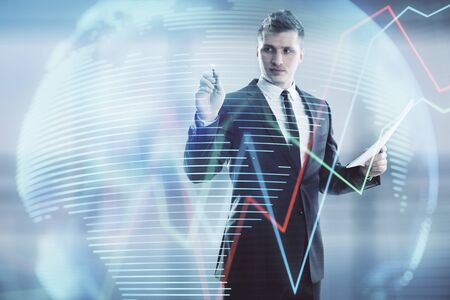 Businessman and forex graph and world map hologram. Double exposure. Concept of financial education and analysis