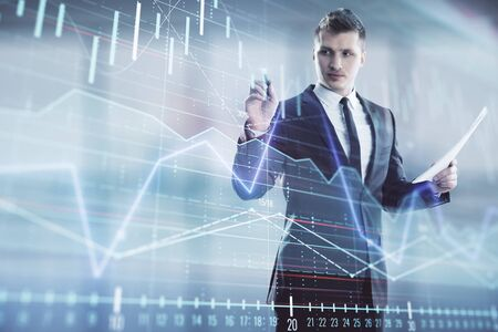 Businessman and forex graph hologram. Double exposure. Concept of financial education and analysis Stockfoto