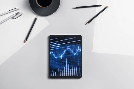 Digital tablet closeup top view with financial graph on screen. Online trading application concept. 3d rendering. Stock Photo