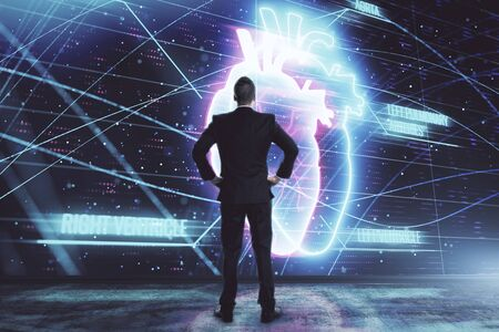 Man and heart drawing hologram. Double exposure. Concept of medical education