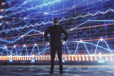 Businessman and forex graph hologram. Double exposure. Concept of financial education and analysis Banco de Imagens