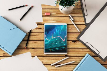 Digital tablet closeup top view with financial graph on screen. Online trading application concept. 3d rendering. Banco de Imagens