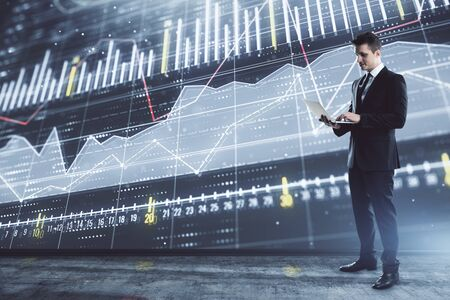 Businessman and forex graph hologram. Double exposure. Concept of financial education and analysis 免版税图像