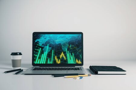 Laptop closeup with forex graph and world map on computer screen. Financial trading and education concept. 3d rendering. Stok Fotoğraf - 137173381