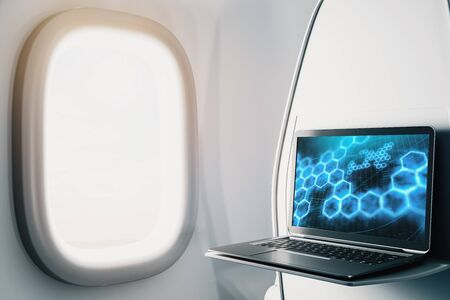 Laptop closeup inside airplane with technology picture on screen. Technology concept. 3d rendering. Stok Fotoğraf - 137173384