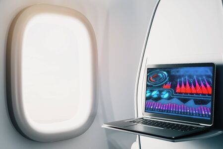 Laptop closeup inside airplane with business theme pic on screen. On air online business concept. 3d rendering. Stok Fotoğraf - 137173484