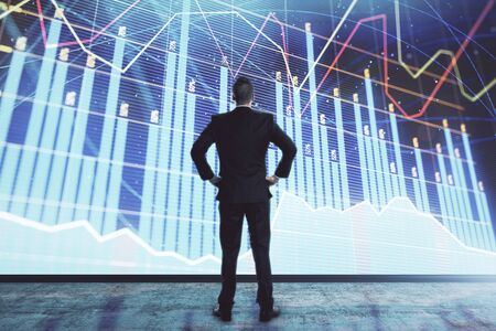 Businessman and forex graph hologram. Double exposure. Concept of financial education and analysis Stock fotó
