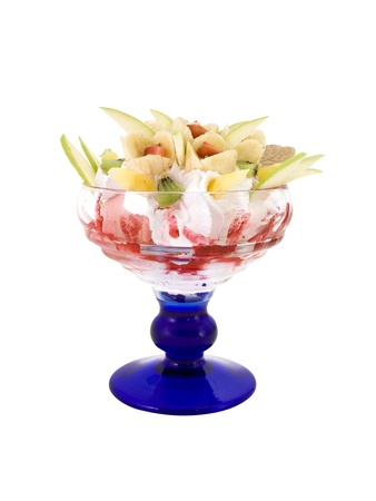 Friut dessert with cream in blue bowl on white background photo