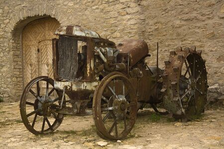 wheeled tractor: Old Machinery. Retro wheeled tractor on neglectedfarm