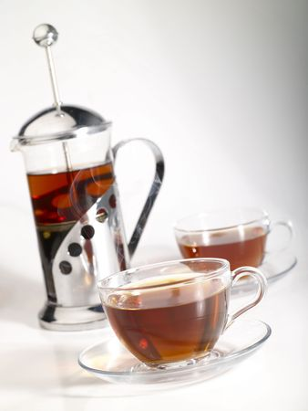 intense flavor: french-press with pair cups of tea and trickle steam