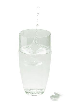 aspirin: glass with water and aspirin pills