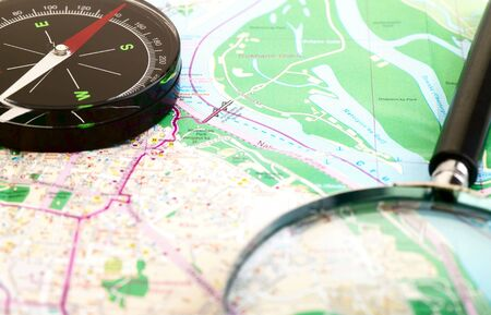 lupe: Travel concept. Map, lupe and compass