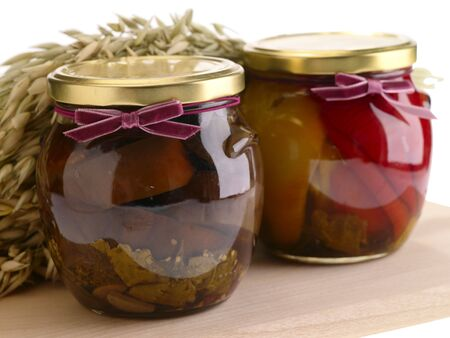 Home preserves on wooden background photo