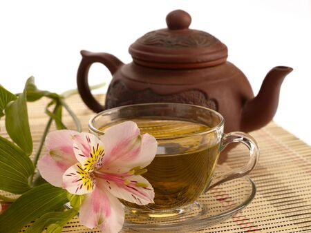 kettles: tea ceremony. Green tea, flower and teapot Stock Photo
