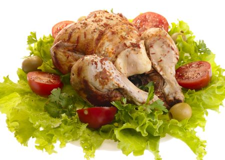 roast chicken: grilled chicken whole with vegetables on salad leafs