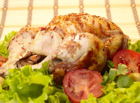 grilled chicken whole with vegetables on salad leafs Stock Photo - 4891312