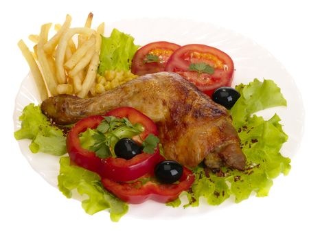 grilled chicken leg with vegetables and chips. isolated with path photo