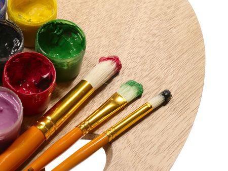 rgb: paintbrushes on wooden palette. RGB concept Stock Photo