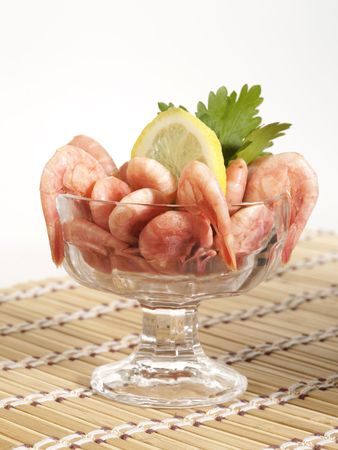 bowl with shrimps on the table with lemon photo