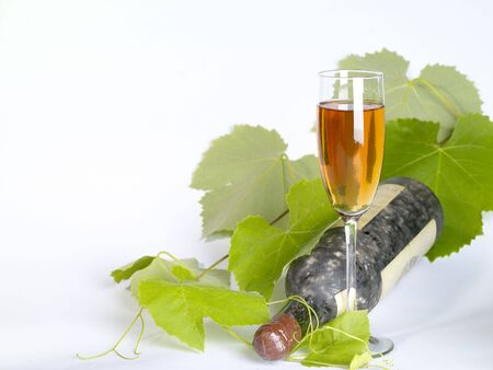unusually: Old  wine still-life. Bottle and glass with grape vine Stock Photo