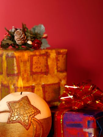 Xmas still-life on red background with candlelight photo