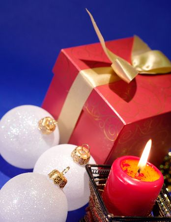 Christmas background with candle and decorations on blue photo