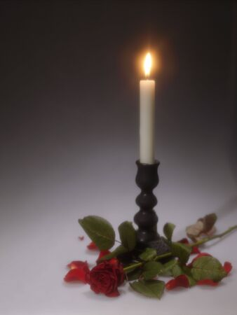 Holidays still-life with candle. Soft focus lens shot photo