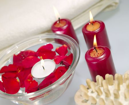 Bathroom still-life with candles and roses petals photo