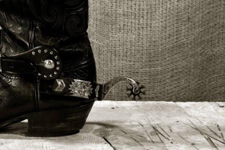 black boots: Western cowboy still life on the desk