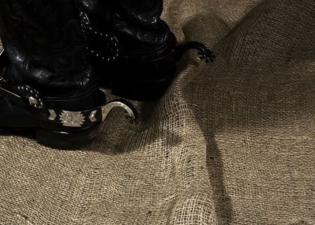 hessian boots: Western still life on the burlap fabric