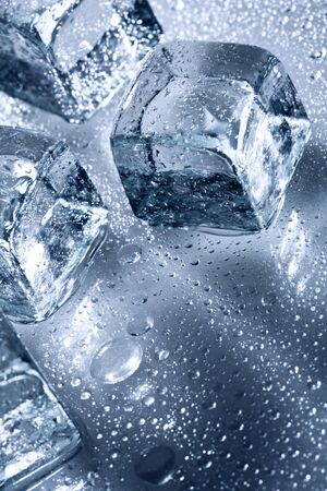 Ice with water droplets over abstract wet background photo