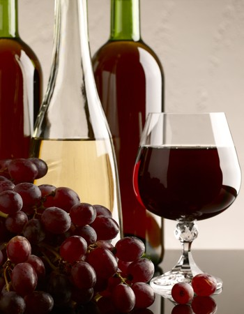 winery still life on the glass with red and white wine photo