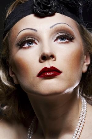 Woman retro revival portrait. 30s of the XX century. Professional makeup Stock Photo - 7161684