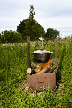 fish soup cooking on the nature over the flame photo