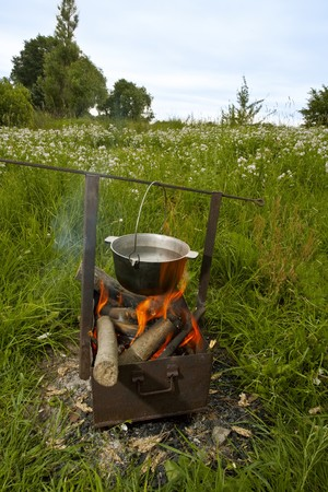 fish soup cooking on the nature over the flame Stock Photo - 7220702