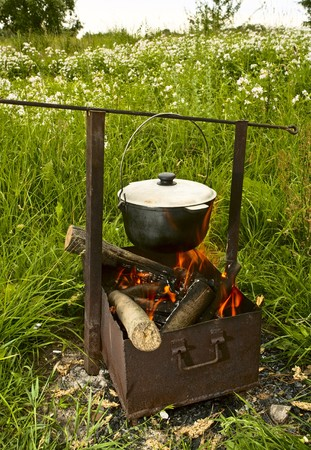 fish soup cooking on the nature over the flame Stock Photo - 7220705