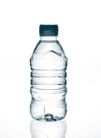 purified: purified spring mineral water in the bottle with reflection