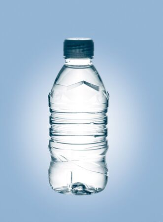 purified: purified spring mineral water in the bottle over blue baclground