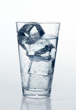glass with cold mineral water, bubbles and ice Stock Photo - 7325010