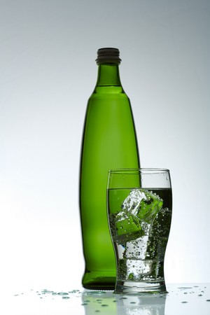 Cold purified water in the glass with bubbles and reflection on the wet background Stock Photo - 7325003