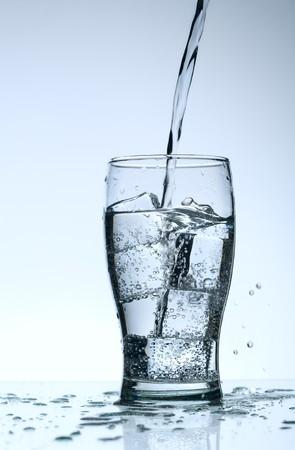 Cold purified water in the glass with bubbles and reflection on the wet background Stock Photo - 7325006