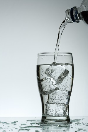 Cold purified water in the glass with bubbles and reflection on the wet background Stock Photo - 7325009