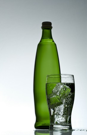 purified: Purified mineral water on the wet glass desk with reflection