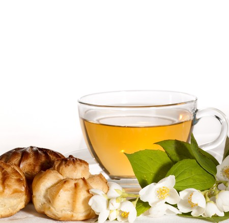clair: cup of herbal jasmine tea with �clair