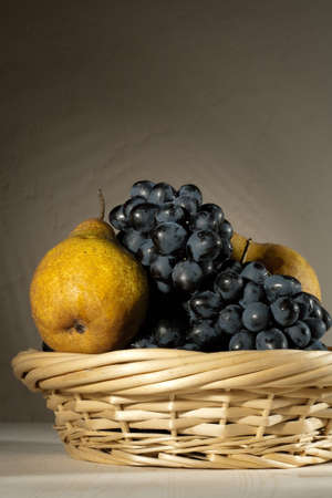 stilllife: fresh tasty fruit in the bast basket  still-life