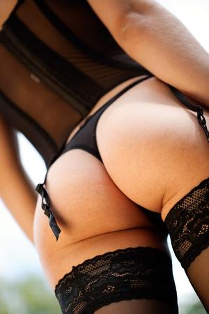 nalga: Lencer�a. Espalda, nalgas y ropa interior de la mujer Foto de archivo