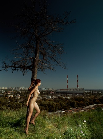loneliness in the city. urban scene with naked girl Stock Photo - 10698015
